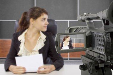Female reporter in news room