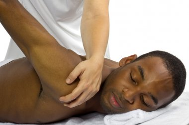 Therapist helping male patient