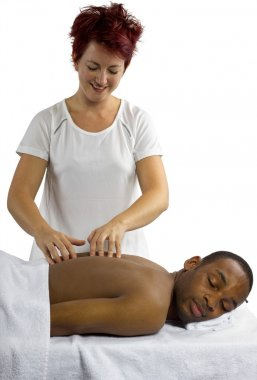 Therapist examining male spinal column