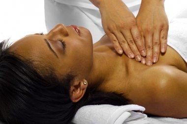 Therapist masseuse treating female
