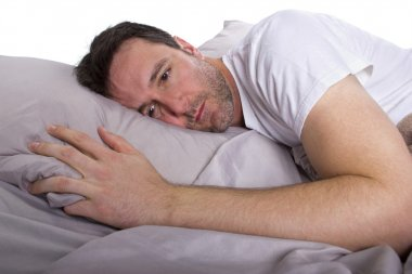 Man suffering from insomnia  in bed