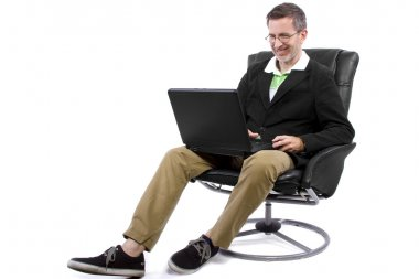 Male working in relaxing chair