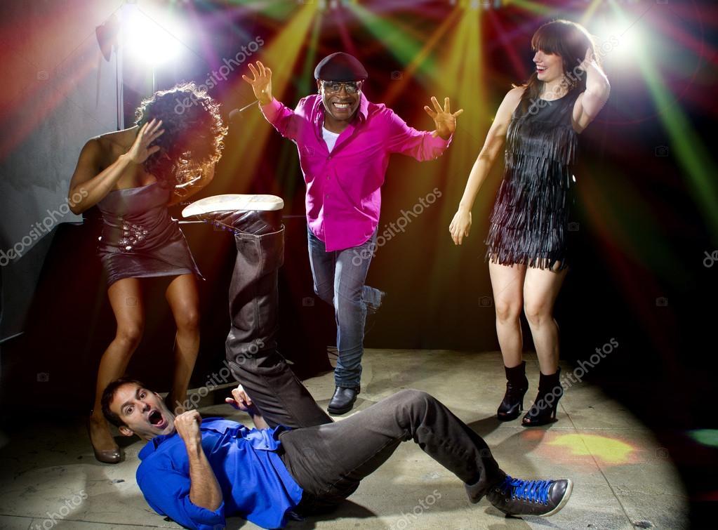 Caucasian man falls in dance club