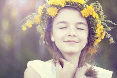 Little girl dreaming in the park
