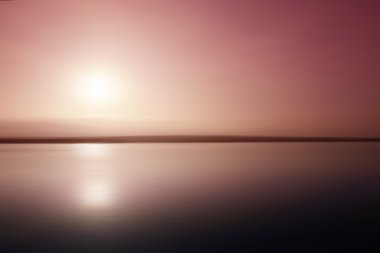 Pink sunset reflected in a lake