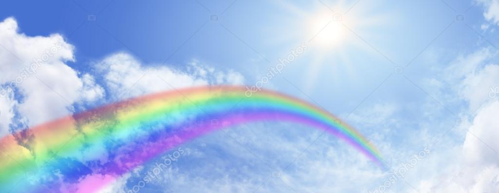Blue sky and beautiful rainbow banner