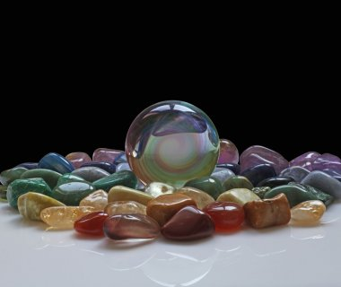 Crystal Ball surrounded by healing crystals