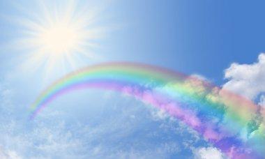 Deep wide blue sky banner with rainbow and sunburst