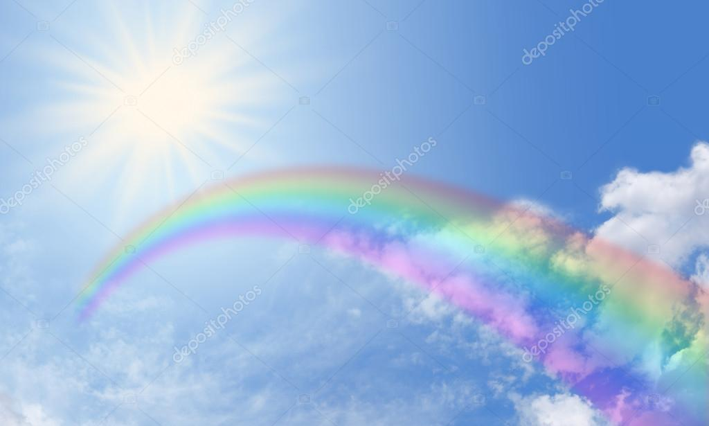 Deep wide blue sky banner with rainbow and sunburst
