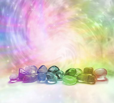 Selection of rainbow colored crystals on a rainbow colored swirling energy background with sparkles stock vector