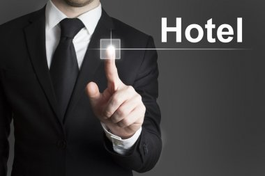 businessman pressing virtual button hotel