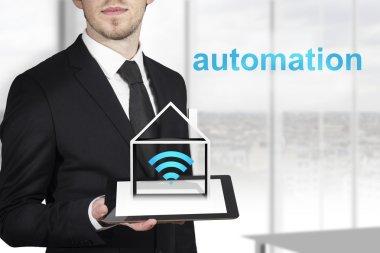 Businessman tablet automation home