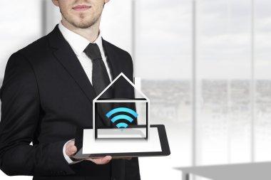 Businessman tablet automation house