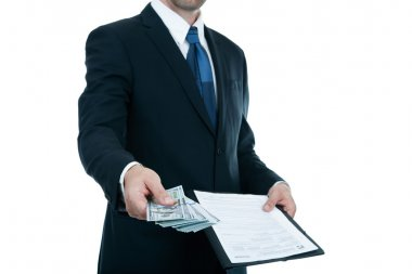 Businessman gives money for a contract on a white background