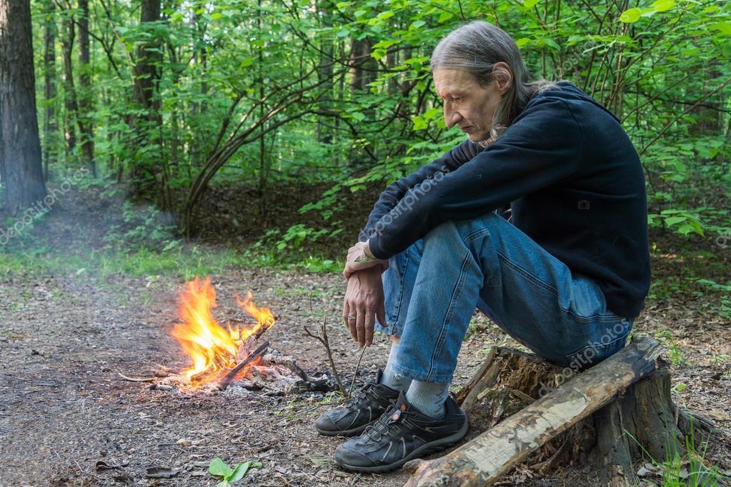 Sad man at a fire