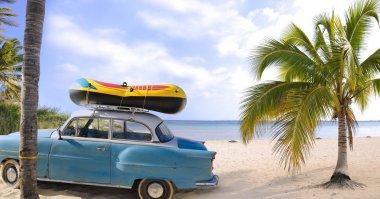 Old car in tropical beach