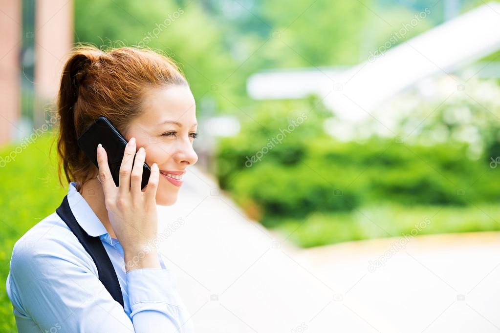 Business woman on a phone, outdoors