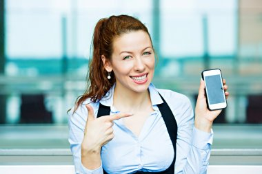 Satisfied customer pointing at her smart phone