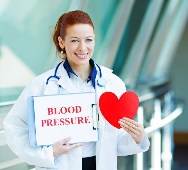 Doctor holding heart and blood pressure sign