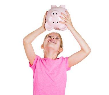 Little girl shaking her piggy bank
