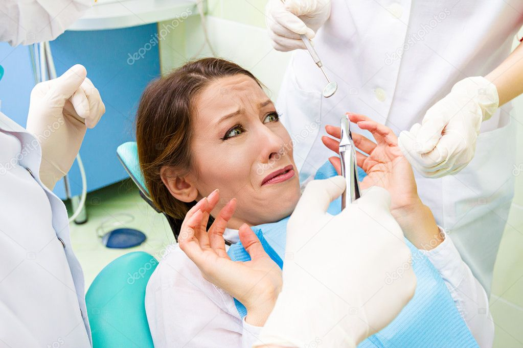 Closeup Portrait Young Terrified Girl Woman Scared At Dentist Visit Siting In Chair Funny Looking With Fear Doesnt Want Dental Procedure Drilling Tooth