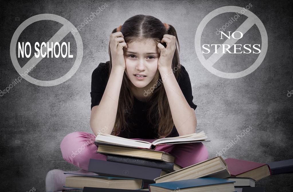 Stressed, tired, overwhelmed little girl, student, pupil