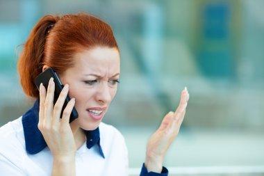 Upset woman having unpleasant conversation on a phone