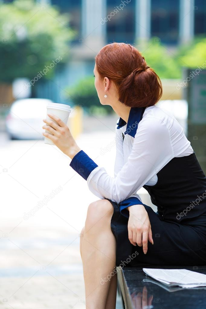 Depressed business woman on coffee break
