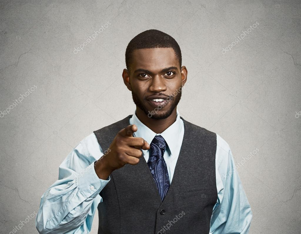 Confident businessman, pointing finger at you