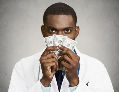 Greedy health care professional, doctor holding cash, money