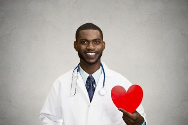 Portrait male doctor holding red heart