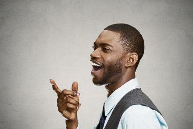 Headshot happy, laughing business man pointing finger at someone