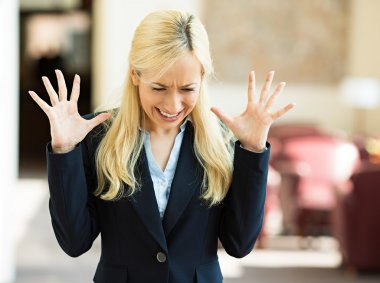 Stressed business woman in corporate office