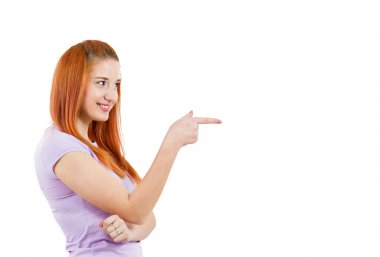 Happy woman pointing finger at someone