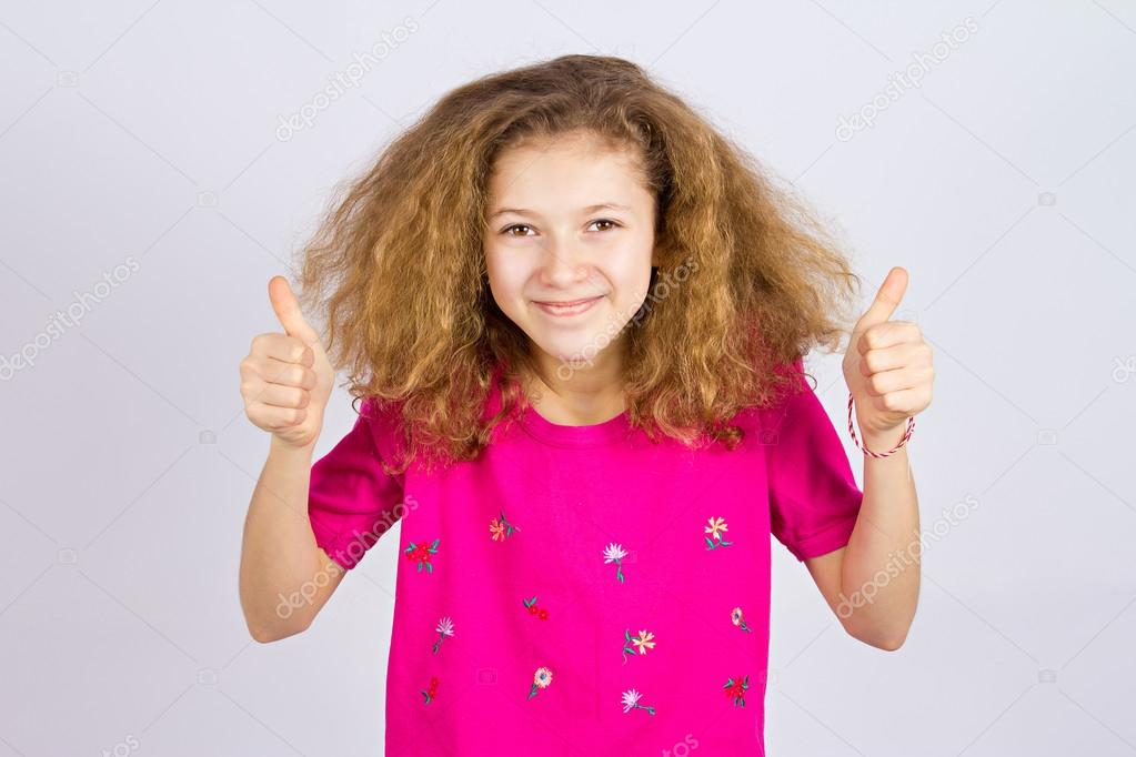 Happy teen girl giving thumbs up
