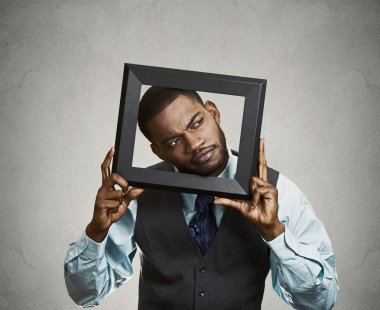 Portrait young funny executive man sticking head in picture fram