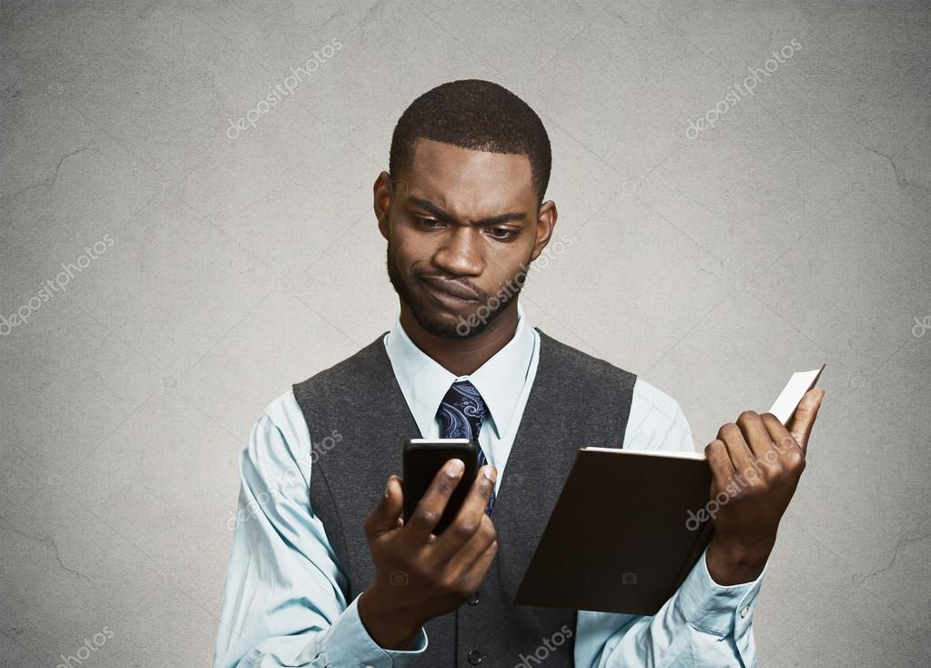 Skeptical executive reading breaking news on smart phone