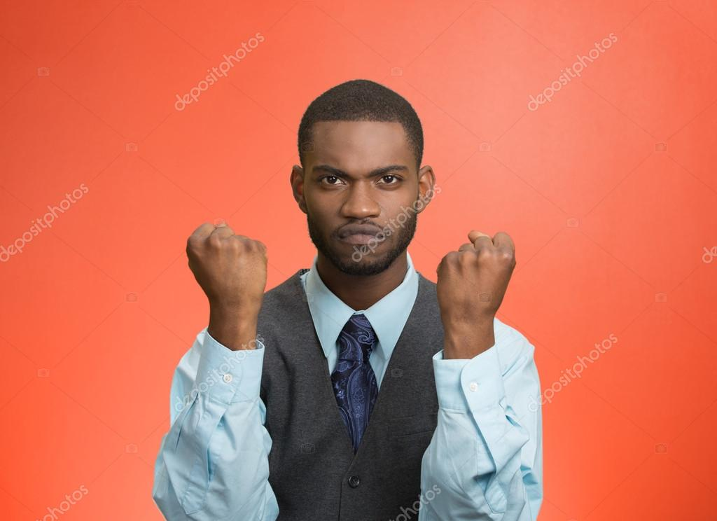 Angry man with fists up in air