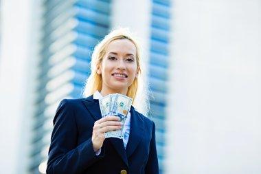 Happy woman holding dollar bills