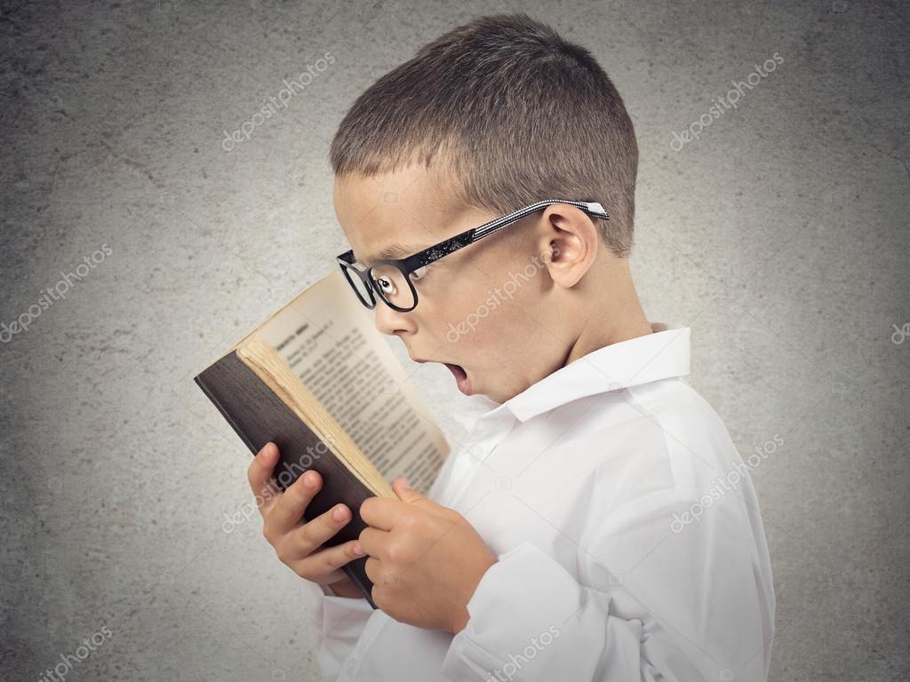 Surprised boy, little man reading book