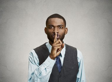 Secret man, finger on lips gesture