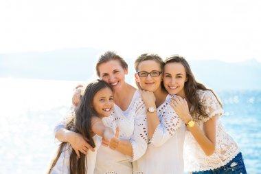 Happy three generation family on a summer seashore vacation