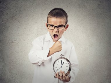 Angry screaming, child, boy holding alarm clock