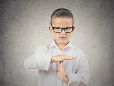 Boy showing time out gesture with hands