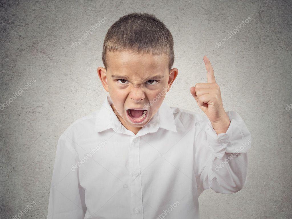 Angry boy screaming, demanding something