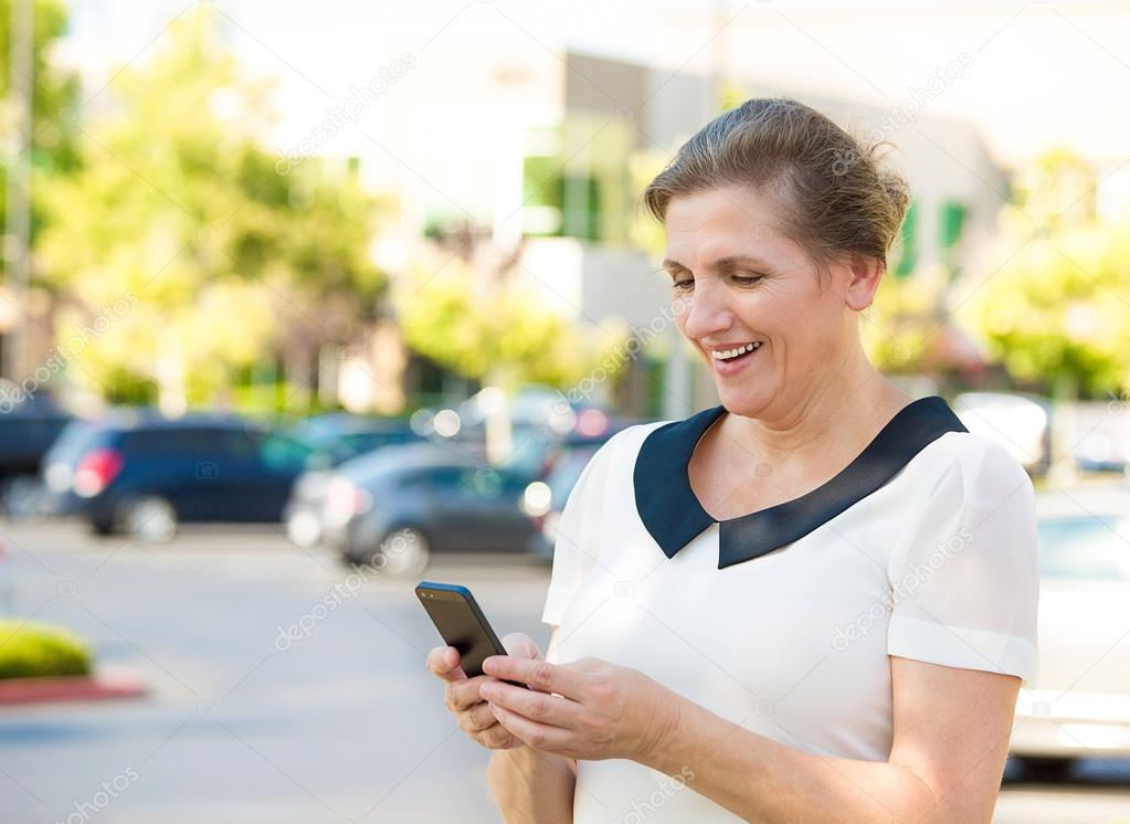 Happy woman texting on her smart phone