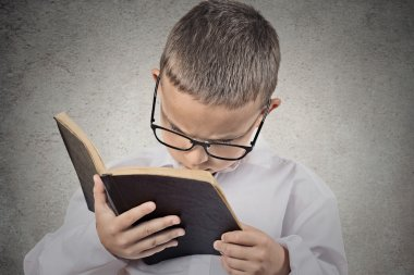 Boy having difficulty to read text, vision problems.