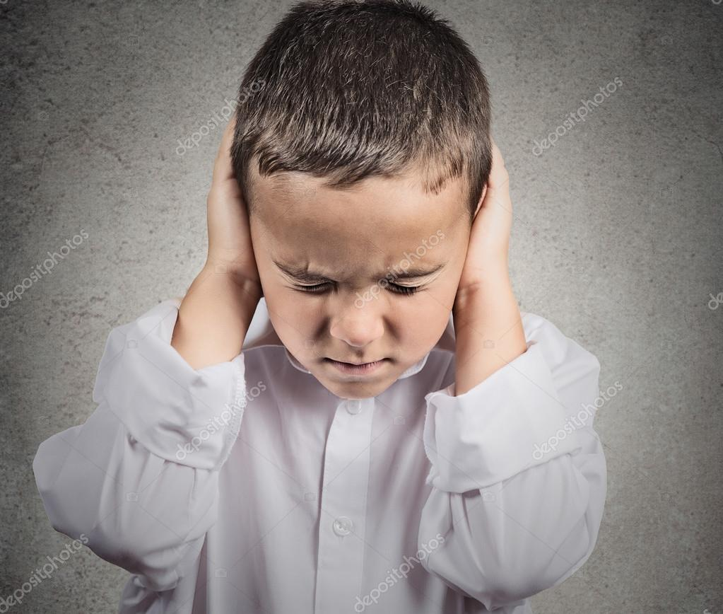 Boy Covers his Ears, hear no evil concept