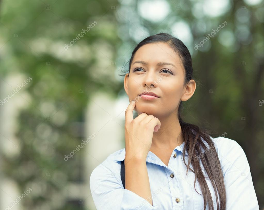 Young Businesswoman daydreaming, Thinking