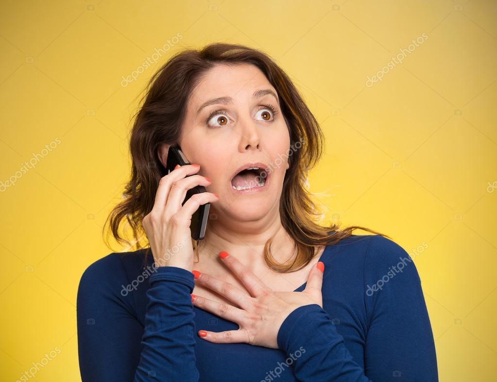 Woman receiving shocking news on a phone